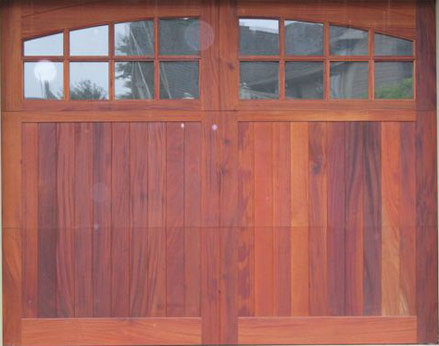 Wood Garage Door with Radius Windows and molding ... & Custom Hardwood French Doors | Exterior u0026 Interior Wooden Doors
